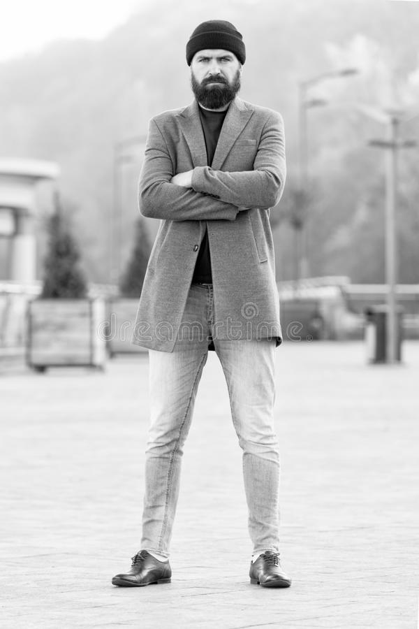 Stylish casual outfit spring season. Menswear and male fashion concept. Man bearded hipster stylish fashionable coat and. Hat. Comfortable outfit. Refreshing stock image