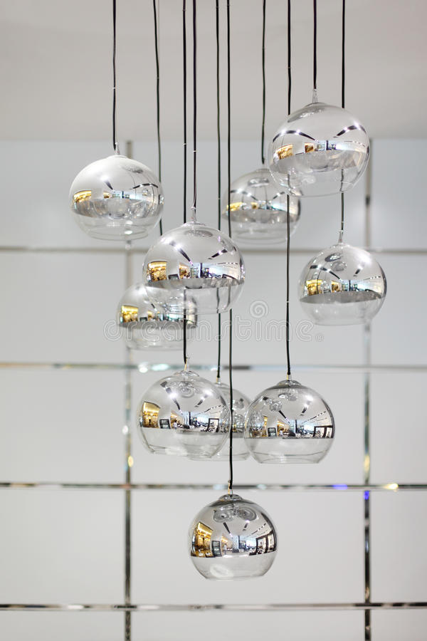 Stylish chandelier with round mirror shades. Which room reflected royalty free stock photography