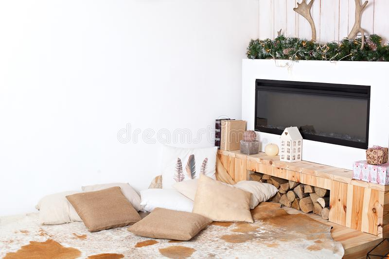 Stylish Christmas scandinavian minimalistic interior with an elegant sofa. Comfort home. Modern country house interior with wooden royalty free stock photos