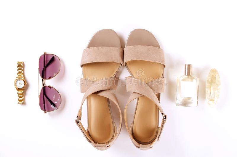 Top view of fashionable feminine medium heeled women`s leather shoes of pastel colors on heels / wedge for spring-summer season. stock photo