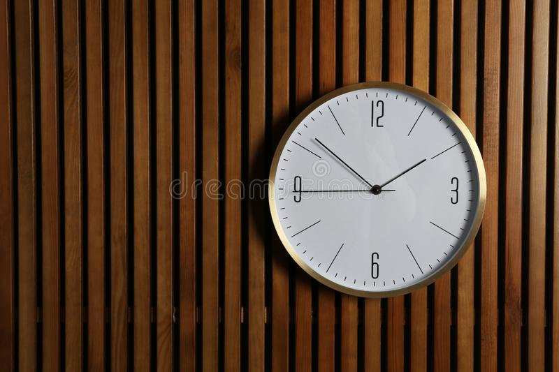 Stylish clock and space for text on wooden background. Time management stock images