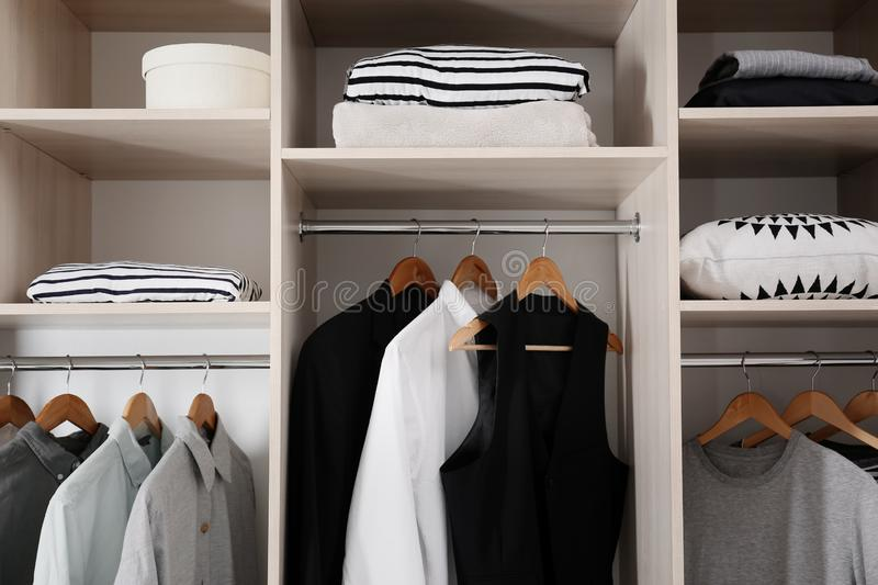 Stylish clothes and home stuff. In large wardrobe closet stock photos
