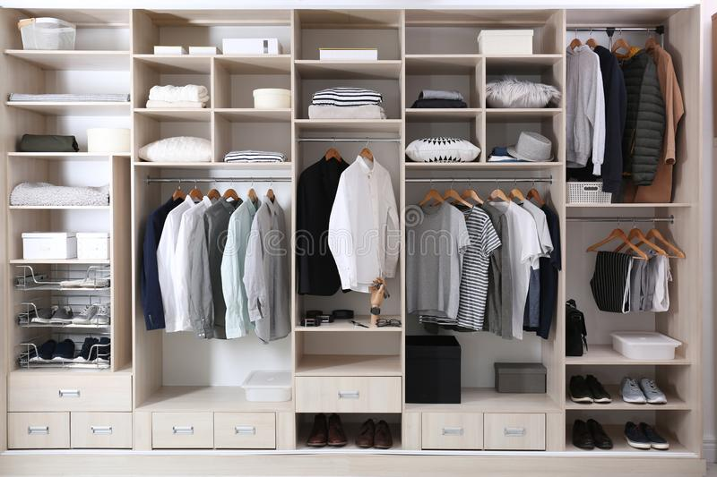 Stylish clothes, shoes and home stuff. In large wardrobe closet royalty free stock image