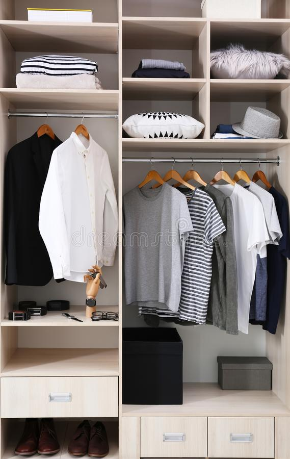 Stylish clothes, shoes and home stuff in large closet. Stylish clothes, shoes and home stuff in large wardrobe closet royalty free stock photo