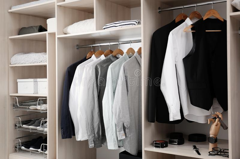 Stylish clothes, shoes and home stuff in large closet. Stylish clothes, shoes and home stuff in large wardrobe closet stock photos