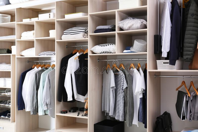 Stylish clothes, shoes and home stuff. In large wardrobe closet royalty free stock photo