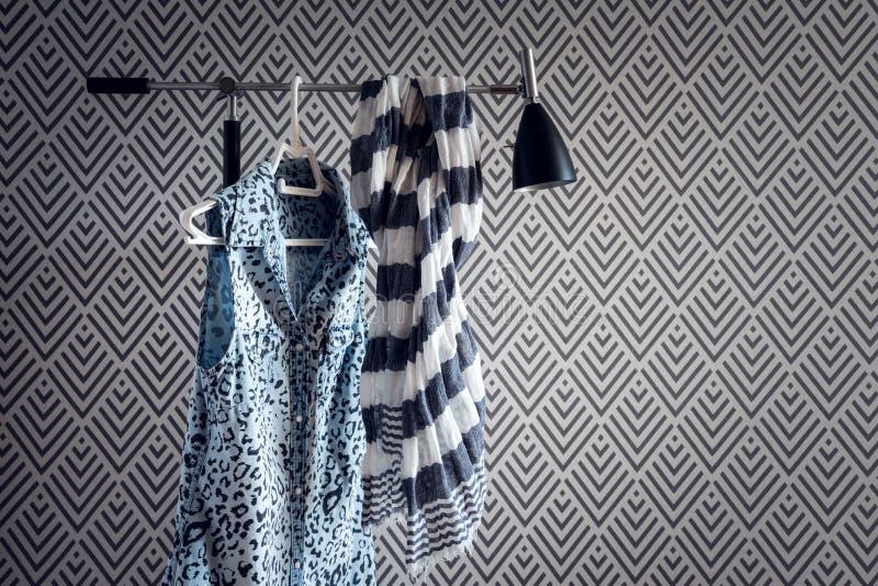 Stylish clothing on wallpaper background stock image