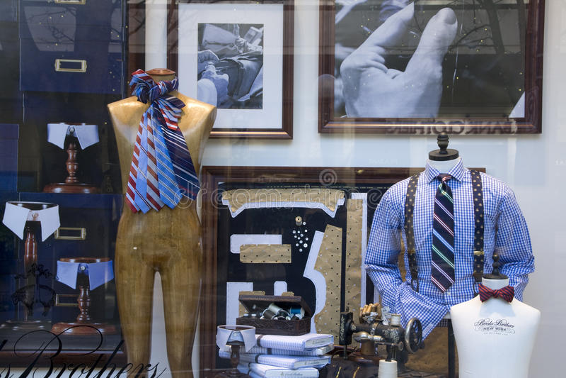 Stylish clothing on window stock images