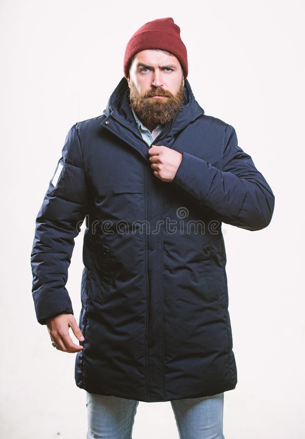Stylish and comfortable. Hipster modern fashion. Guy wear hat and black winter jacket. Hipster style menswear. Hipster stock photos