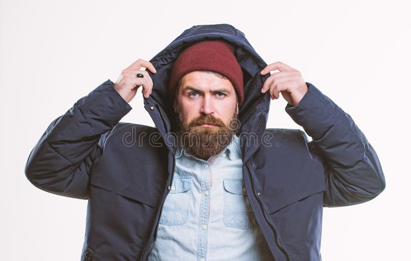 Stylish and comfortable. Hipster style menswear. Hipster outfit. Man bearded hipster stand in warm black jacket parka. Isolated on white. Hipster modern fashion royalty free stock photo