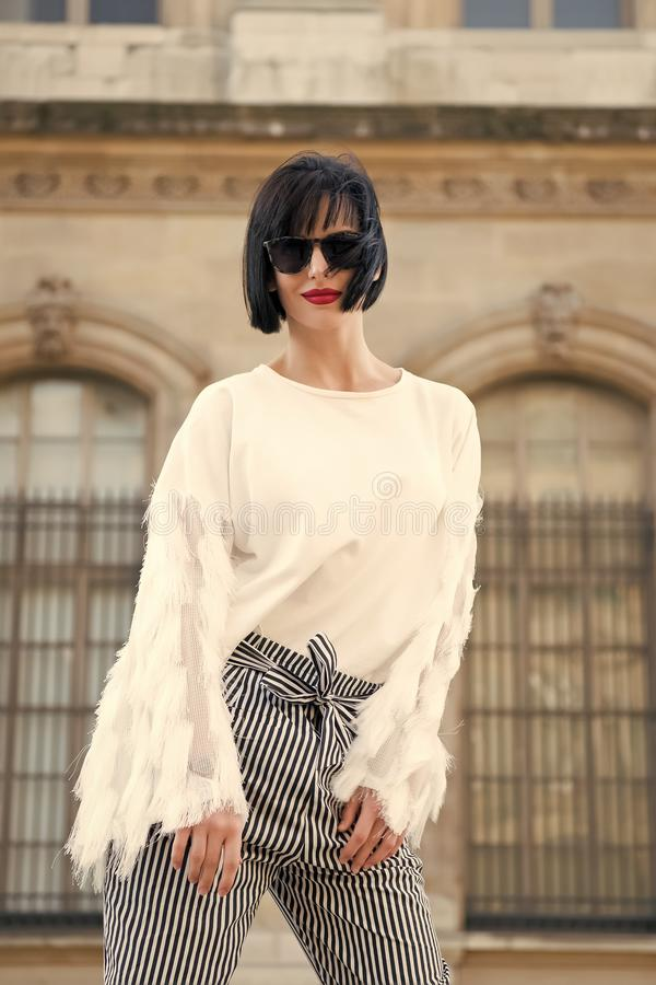 Stylish and comfortable. Woman fashionable model posing outdoor. Girl brunette bob hairstyle looks stylish. Girl stock photography
