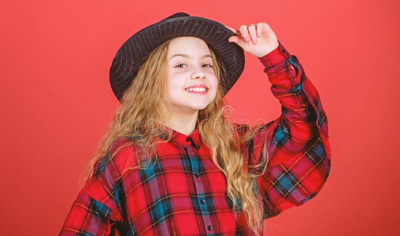 Stylish and confident. Adorable girl wearing fashion hat accessory. Small girl with beauty look. Little girl with long. Blond hair in fashion style. Cute little stock images
