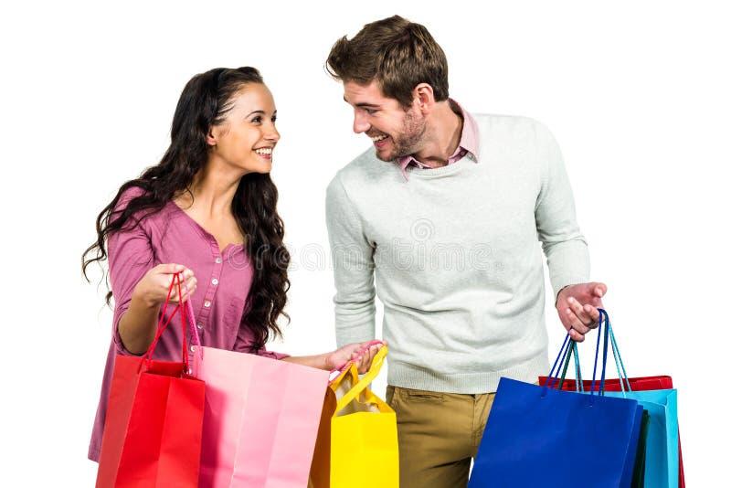 Stylish couple holding shopping bags stock images