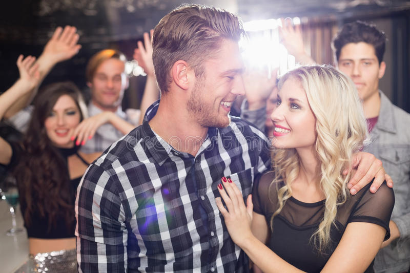 Stylish couple smiling and dancing together stock photos