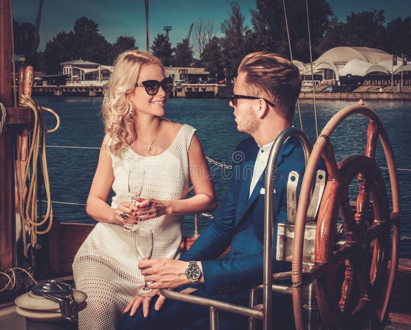 Stylish couple on a yacht royalty free stock photography