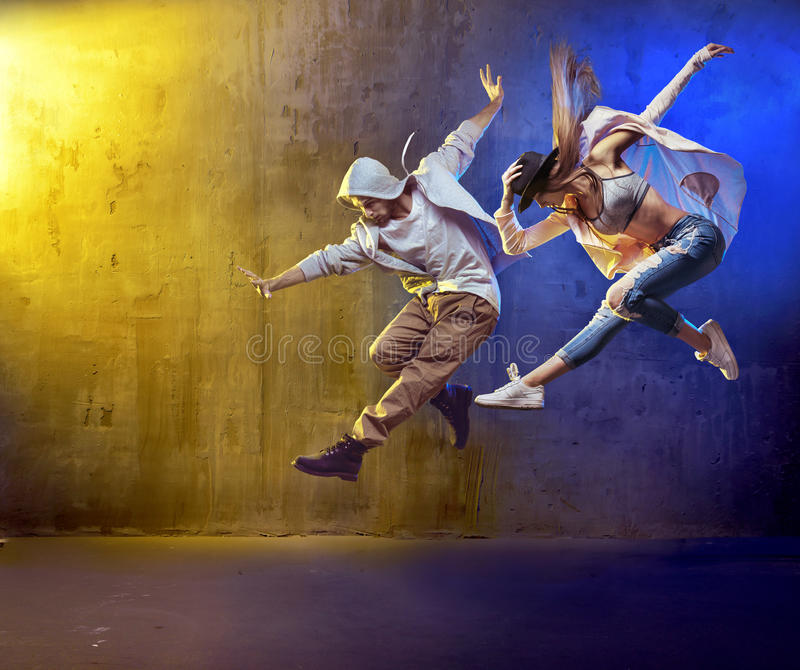 Stylish dancers fancing in a concrete area royalty free stock photography