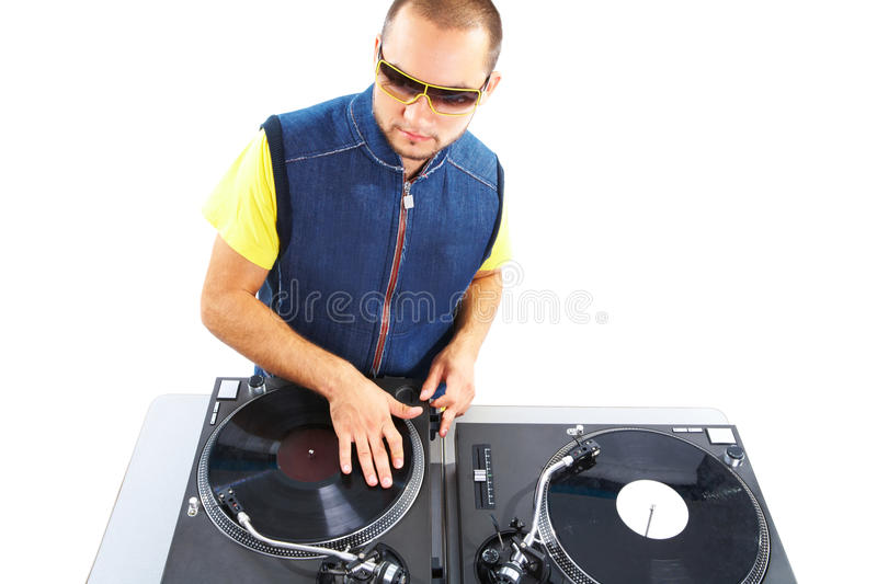 Stylish deejay. Portrait of smart deejay spinning turntables in isolation stock photography