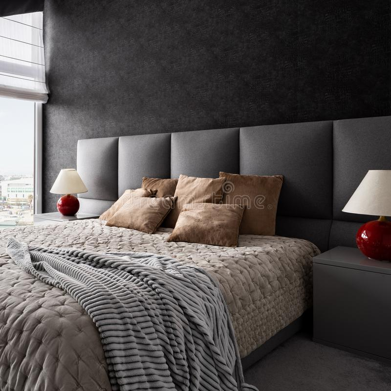 Stylish bedroom with dark wallpaper stock images