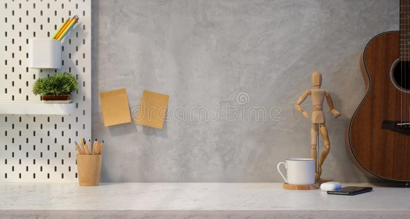 Stylish designer`s workplace with copy space. On marble table and grey wall background royalty free stock images