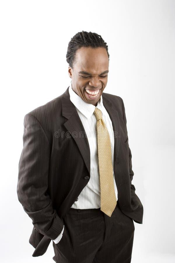Stylish dreadlocks businessman isolated on white. stock photo
