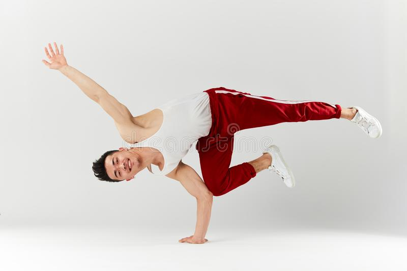Asian personal break dancer trainer doing handstand on white background royalty free stock image