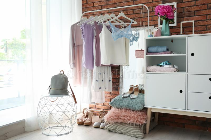 Stylish dressing room interior with clothes stock images