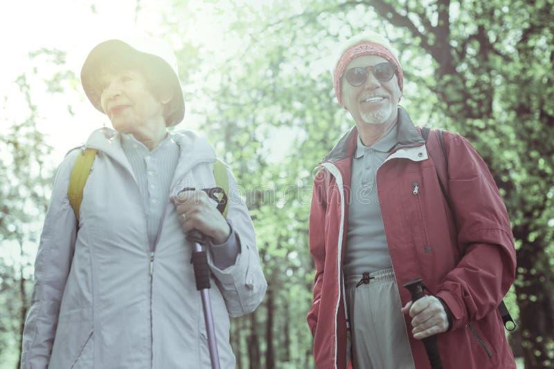 Stylish elderly people hiking on the weekend royalty free stock photography
