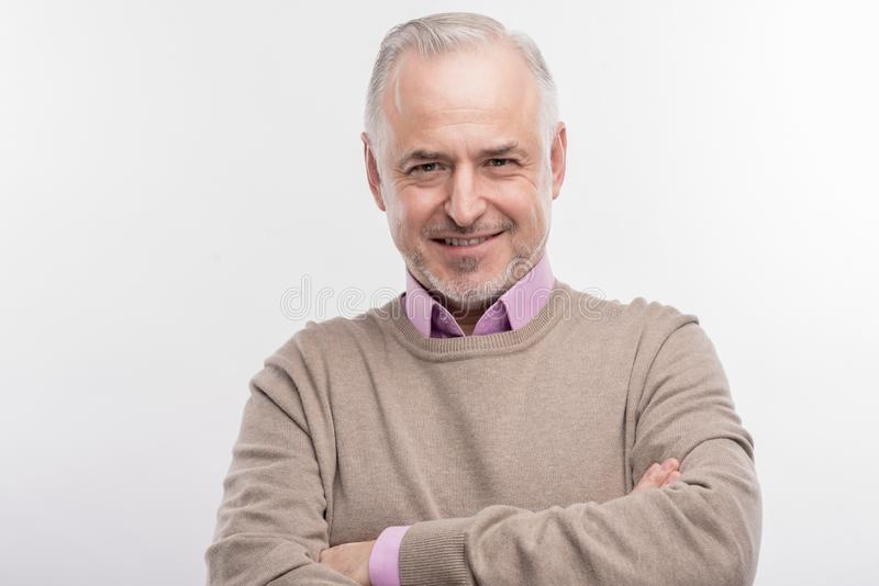 Stylish elderly professor feeling extremely excited before giving lecture stock photos