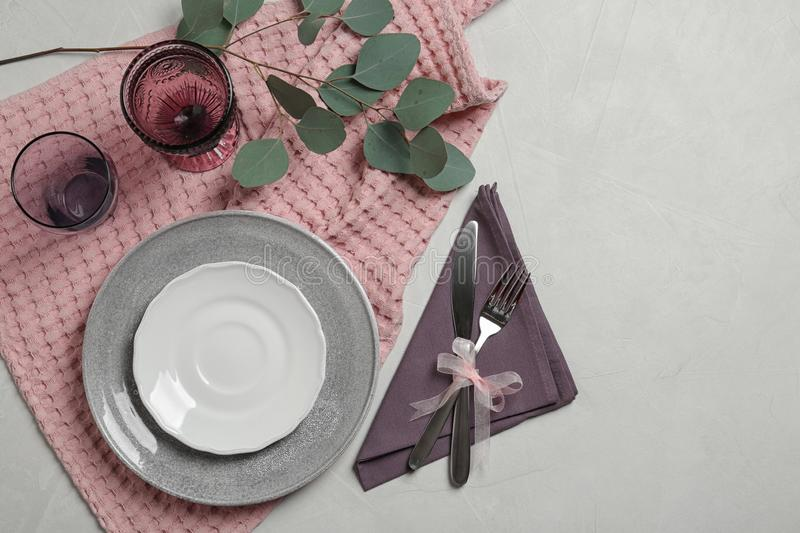 Stylish elegant table setting on light background, top view. Space for text stock image