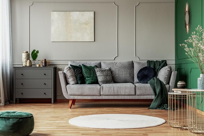 Stylish Emerald Green And Grey Living Room Interior Design With Abstract Painting On The Wall Stock Image Image Of Apartment Home 161508909