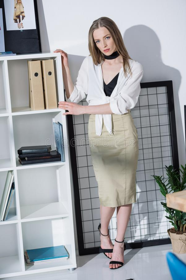 Stylish fashion designer. At modern office stock image
