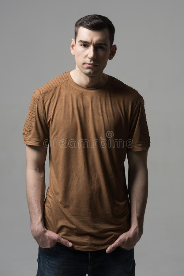 Stylish fashion model man in casual style. Charming handsome. hip hop style for guy in studio. portrait of shaved man in royalty free stock photos