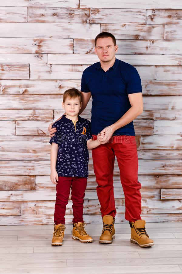 Stylish father and son in identical clothes stock image