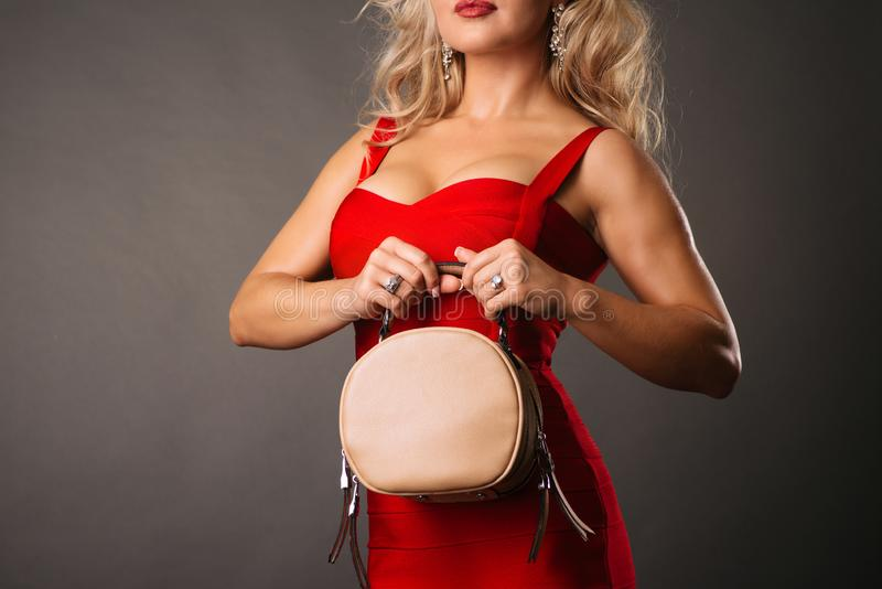Stylish female hand holding handbag. Fashionable women`s accessory royalty free stock photography