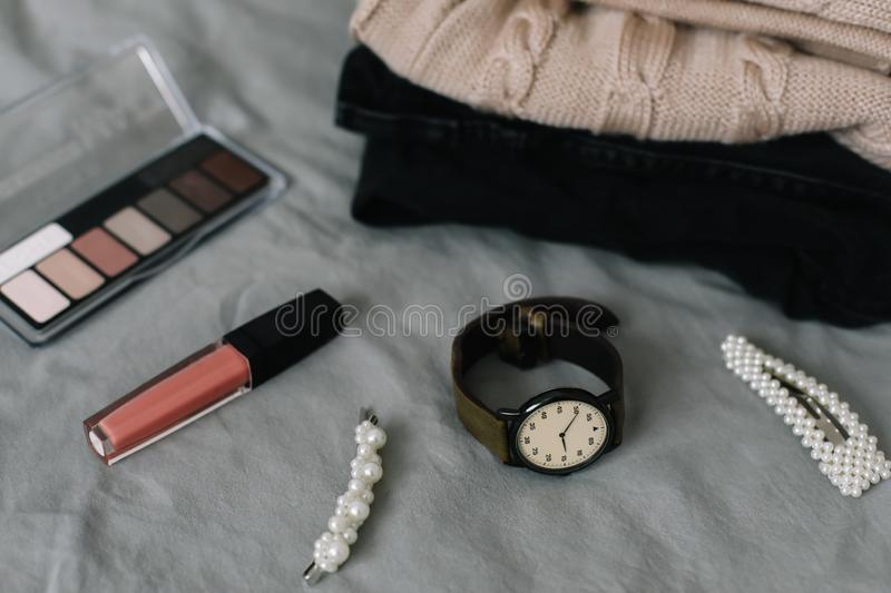 Stylish feminine accessories. Women clothing, hair clips, cosmetics. Beauty  fashion blog concept. top view. Stylized feminine flatlay with lipstick, watch royalty free stock photography