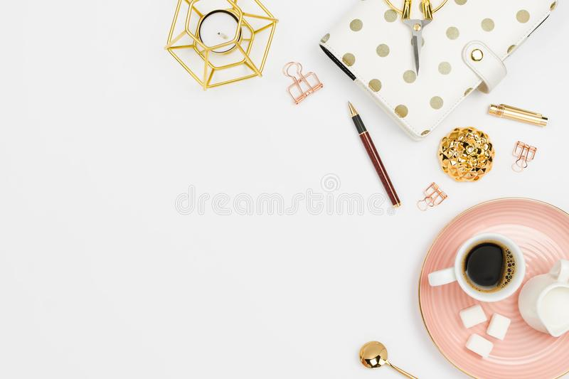 Stylish flatlay arrangement with coffee, milk holder, planner, glasses and other stationary accessories. Feminine business mockup, copyspace, white background royalty free stock image