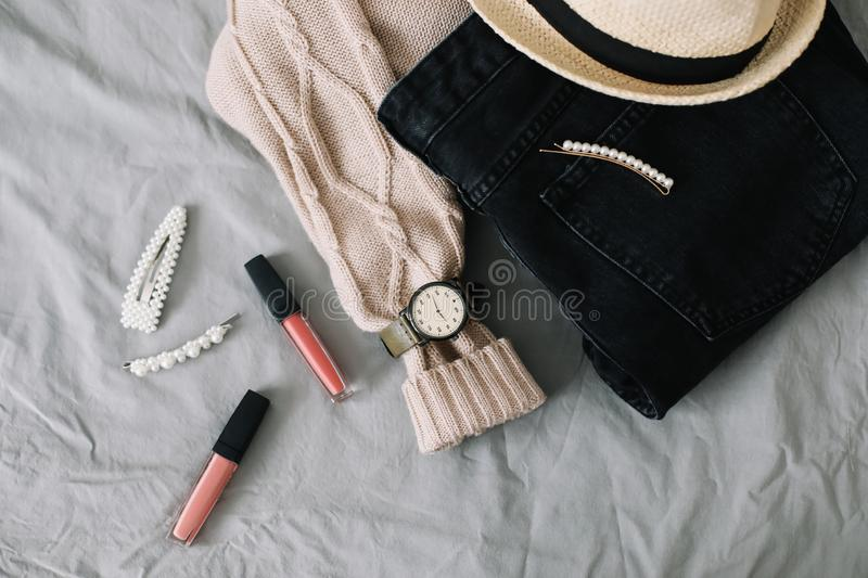 Stylish flatlay arrangement with female fashion clothes and accessories. Stylish feminine outfit concept. Beauty and fashion blog. royalty free stock images