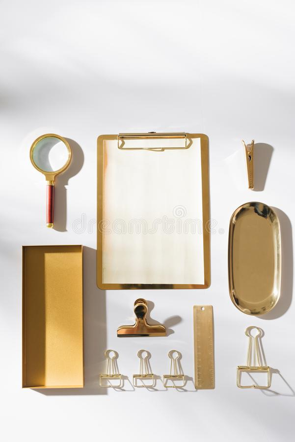 Stylish flatlay arrangement with planner, magnifying and other stationary accessories royalty free stock photos