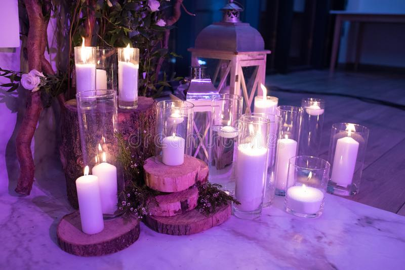A stylish floor decoration of candles and lanterns in the evening stock photos