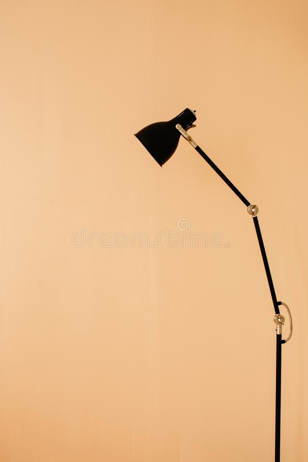 Stylish floor lamp in apartment royalty free stock photography