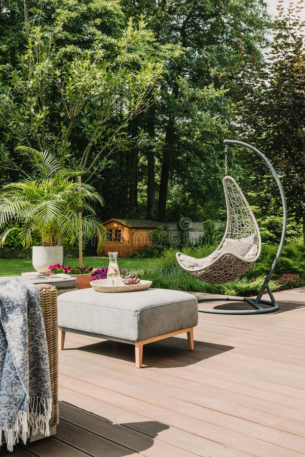 Stylish garden decoration with fancy egg chair and garden furniture. Stylish garden decoration with fancy chair and garden furniture royalty free stock photos