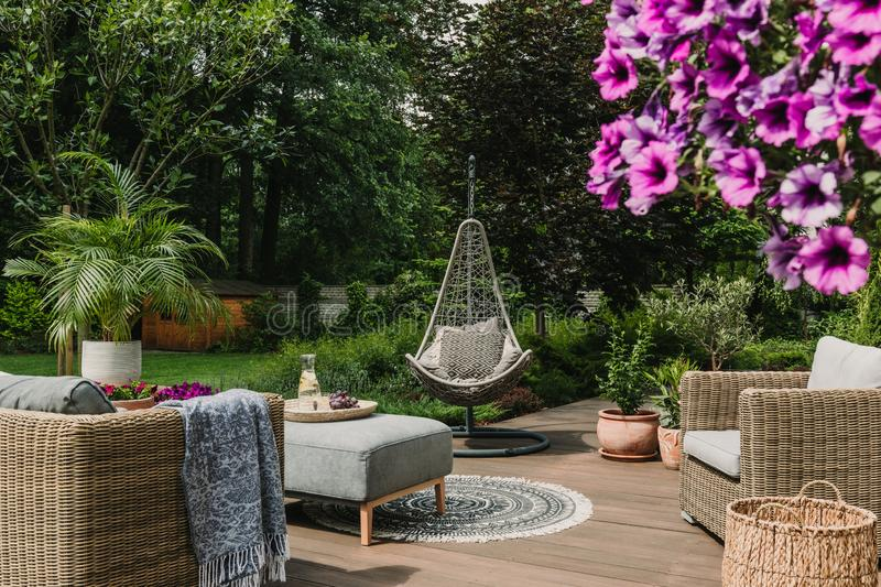 Stylish garden decoration with fancy egg chair and garden furniture. Stylish garden decoration with fancy chair and garden furniture stock photo