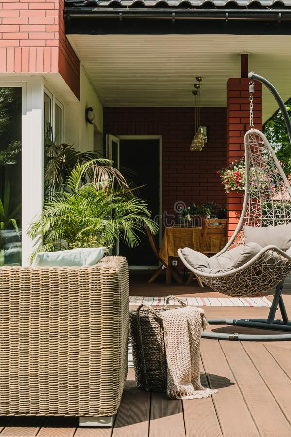 Stylish garden decoration with fancy egg chair and garden furniture. Stylish garden decoration with fancy egg chair and furniture royalty free stock images