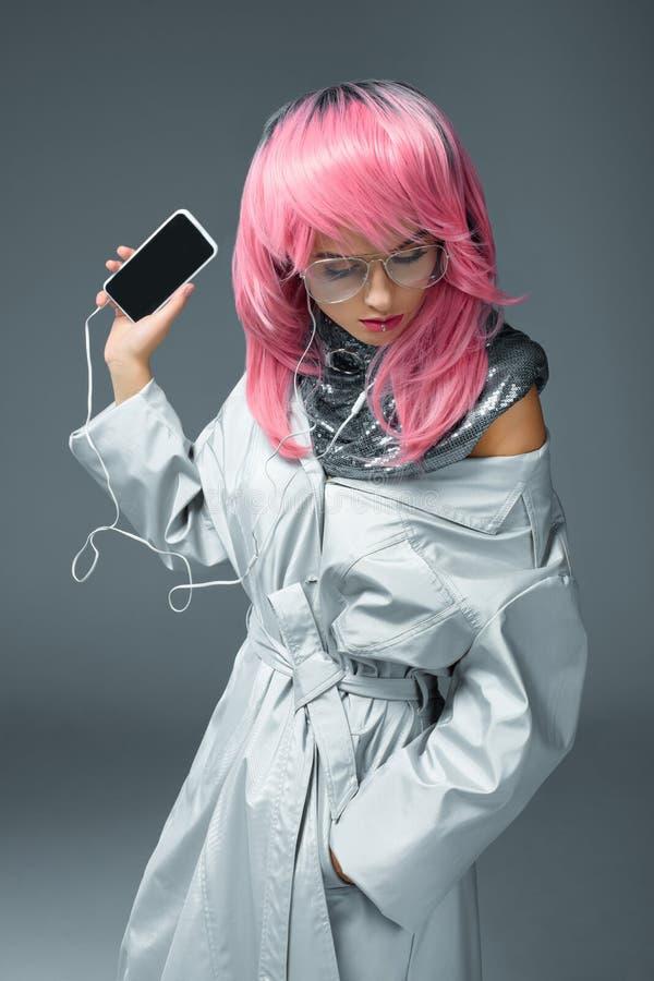 stylish girl with earphones and smartphone stock photography