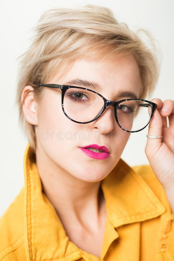 Stylish girl with eyeglasses. Eyesight and eye health. Good vision. High quality lens. Fashionable eyeglasses. Woman. Adorable blonde wear eyeglasses close up stock photos