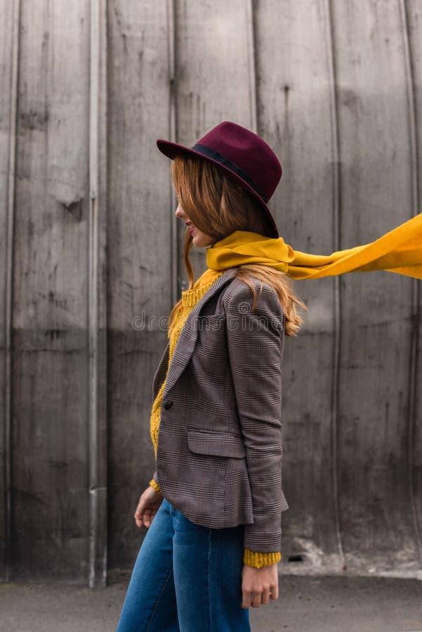 beautiful stylish redhead girl in fedora hat royalty free stock photography