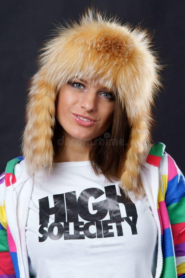 Stylish girl in fur hat stock photo