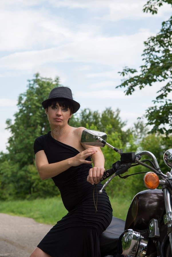 Stylish girl on nature with bike stock photos