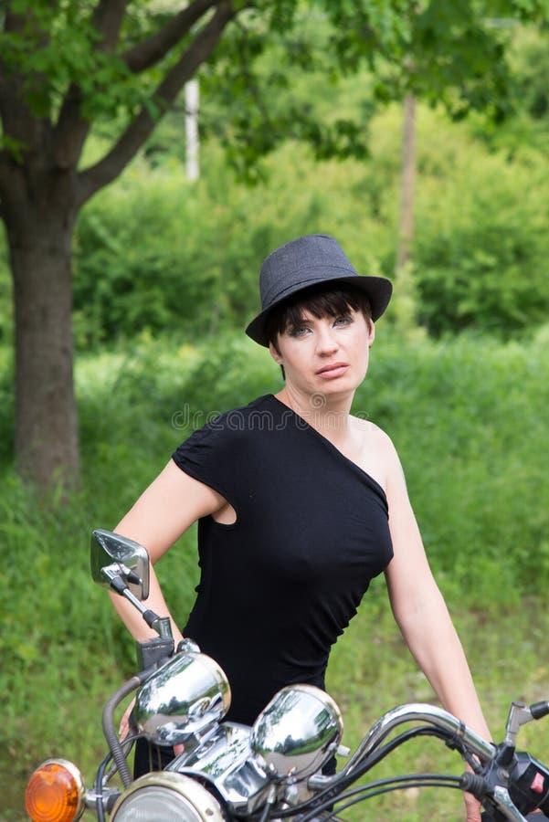 Stylish girl on nature with bike royalty free stock photo