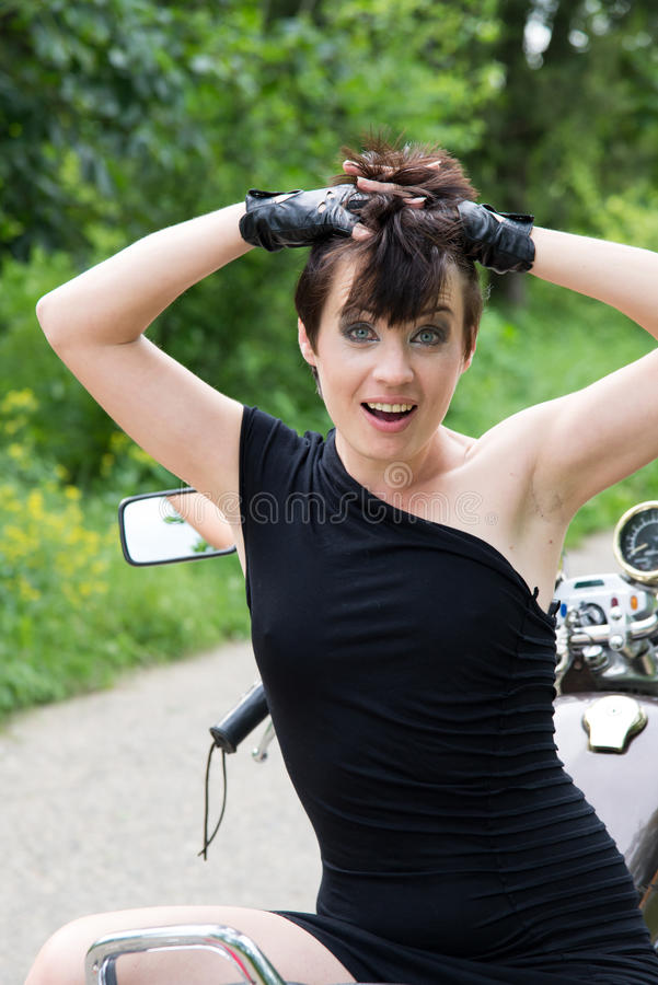 Stylish girl on nature with bike royalty free stock photography